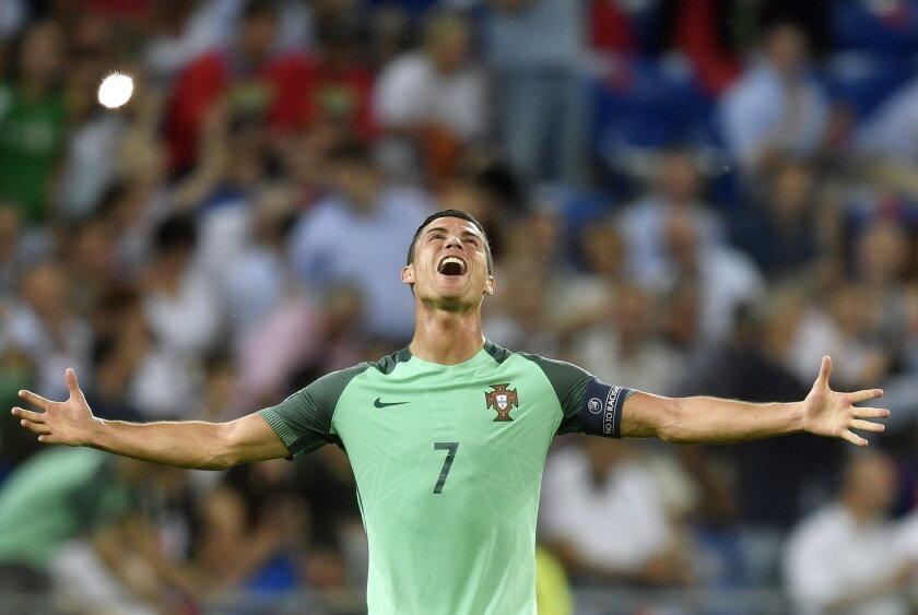 Portugal's Cristiano Ronaldo celebrates at the end of the Euro 2016 semifinal soccer match between Portugal and Wales, at the Grand Stade in Decines-Charpieu, near Lyon, France, Wednesday, July 6, 2016. Portugal won 2-0. (AP Photo/Martin Meissner)