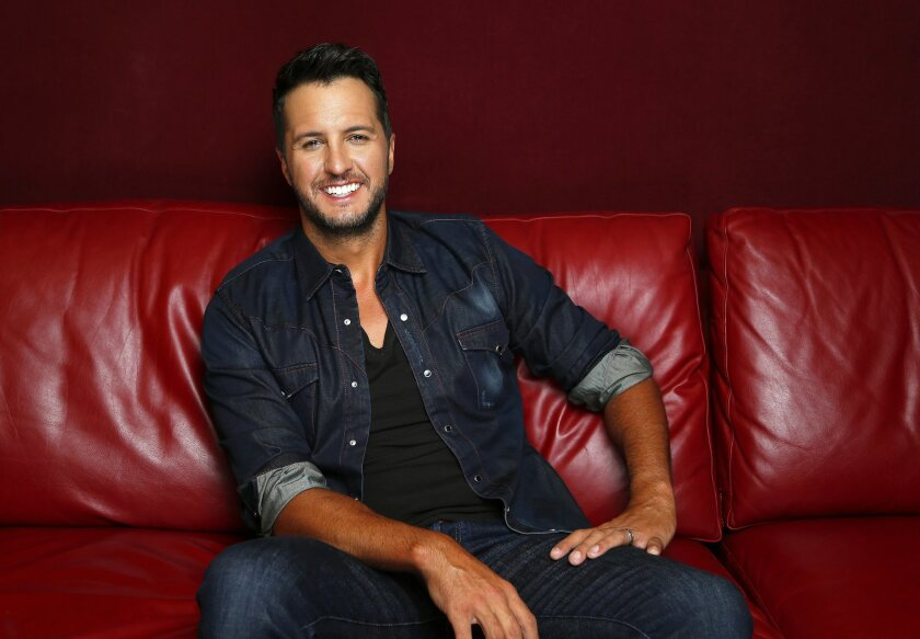 """In this July 14, 2015 photo, Luke Bryan poses for a portrait at Audio Productions in Nashville, Tenn., to promote his latest album, """"Kill the Lights."""" (Photo by Donn Jones/Invision/AP)"""
