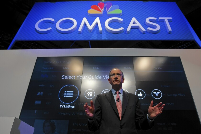 """""""We view this as a merger that creates a company on the leading edge of innovation,"""" Comcast Chief Executive Brian Roberts said on a call with Wall Street analysts. Above, Roberts speaks at an event last year."""