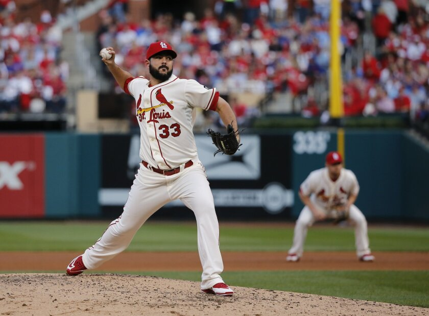 St. Louis Cardinals' Carlos Villanueva (33) throws during the fourth inning of Game 2 in baseball's National League Division Series against the Chicago Cubs, Saturday, Oct. 10, 2015, in St. Louis. (AP Photo/Charles Rex Arbogast)