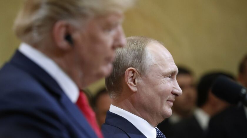 Russian President Vladimir Putin smiles during a press conference with U.S. President Donald Trump.