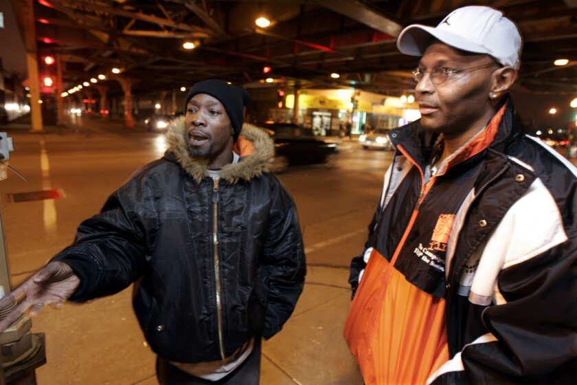 """CeaseFire """"violence interrupters"""" Alphonso Prater, left, and Karl Bell patrol the streets of Chicago on Feb. 1, 2006."""