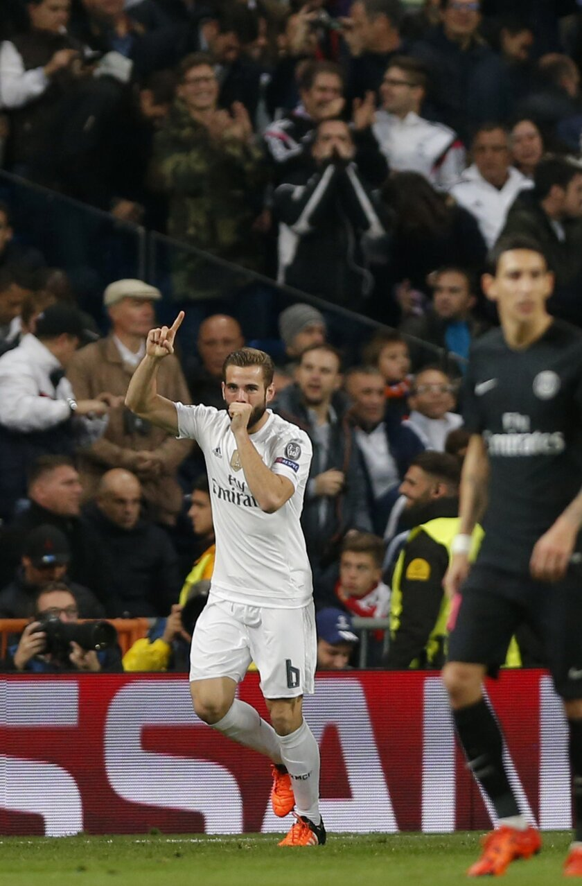 Real Madrid's Nacho Fernandez reacts after scoring the opening goal during their Group stage of Champion's League Group A soccer match against Real Madrid at the Santiago Bernabeu stadium in Madrid, Spain, Tuesday, Nov.3, 2015. (AP Photo/Daniel Ochoa de Olza)