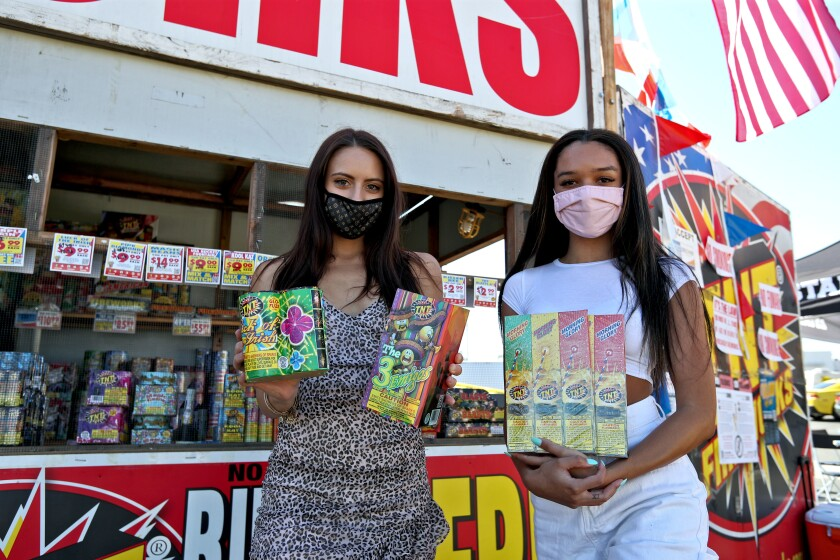Shoppers Maddie Purkis, 21, left, and Taylor Pernicone, 20, looking for fireworks stopped by a TNT Fireworks in Costa Mesa.