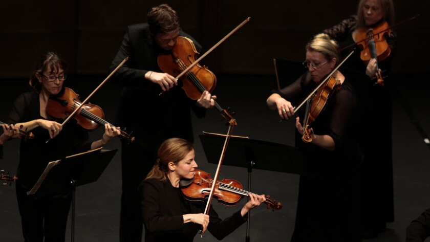 Karina Canellakis, lower center, performs both as soloist and conductor with the L.A. Chamber Orchestra in Vivaldi's violin concerto at Royce Hall on Jan. 25, 2015.