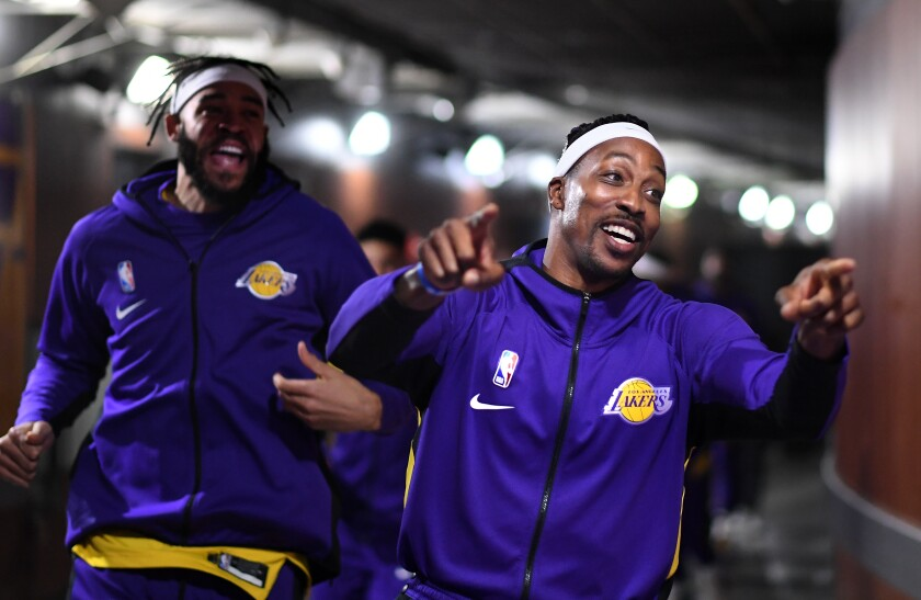 Dwight Howard leads Lakers to the court before Jan. 7 Knicks game at Staples Center.