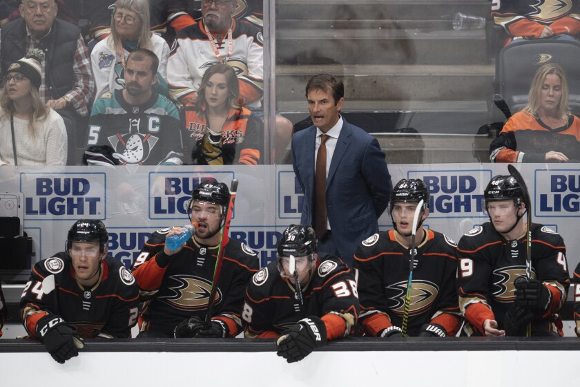 Ducks coach Dallas Eakins, top, yells instructions to his players during the third period against the Arizona Coyotes on Thursday at Honda Center.