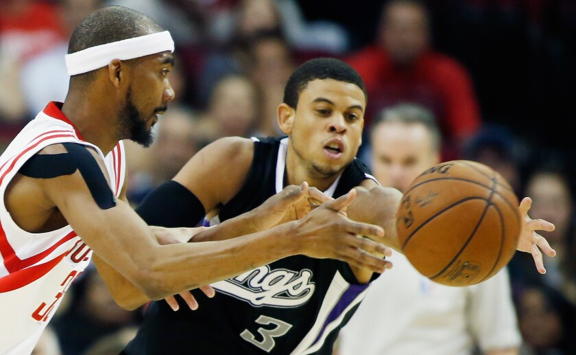 Ray McCallum Jr. (3) chases after a loose ball while a member of the Sacramento Kings against Rockets forward Corey Brewer. The California native has since played in China.