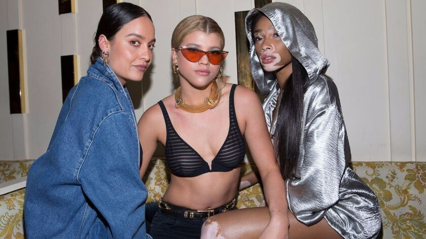 From left, an unidentified party guest, Sofia Richie and Winnie Harlow.