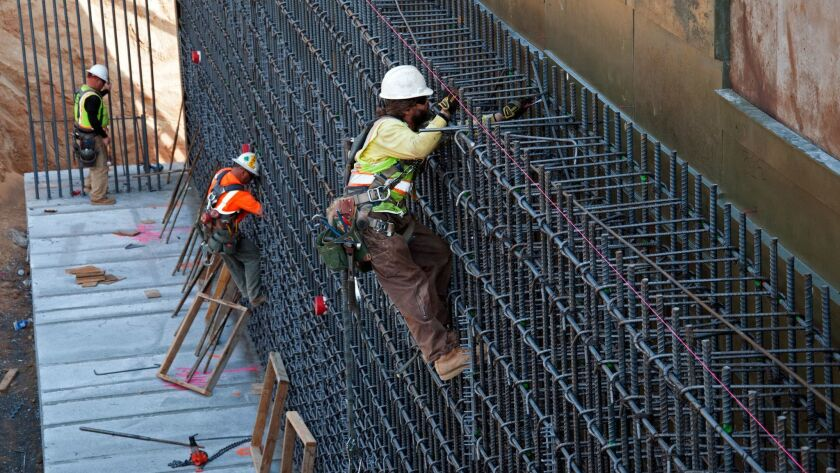 Ironworkers tie rebar for the walls of the undercrossing at Tulare Street in downtown Fresno on Dece