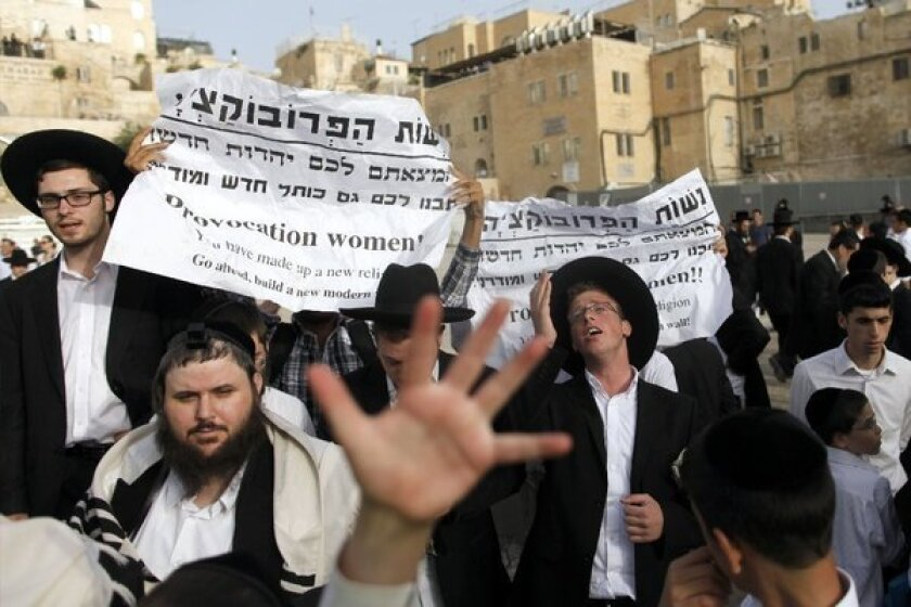 Ultra-Orthodox Jewish men protest against the group Women of the Wall as they prayed at the Western Wall in Jerusalem on Sunday.