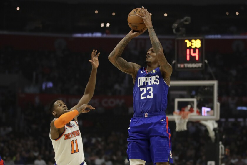 Clippers guard Lou Williams shoots over New York Knicks' Frank Ntilikina on Jan. 5 at Staples Center.