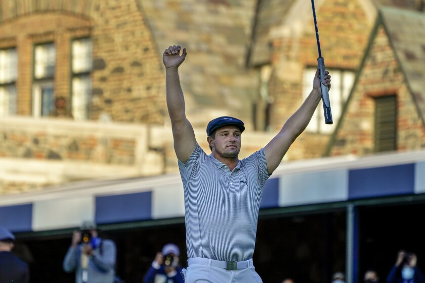 FILE - In this Sunday, Sept. 20, 2020, file photo, Bryson DeChambeau, of the United States, reacts after sinking a putt for par on the 18th hole to win the U.S. Open golf tournament in Mamaroneck, N.Y. DeChambeau's first major validated his work at getting bigger and stronger. He is the favorite going into the Masters. (AP Photo/Charles Krupa, File)