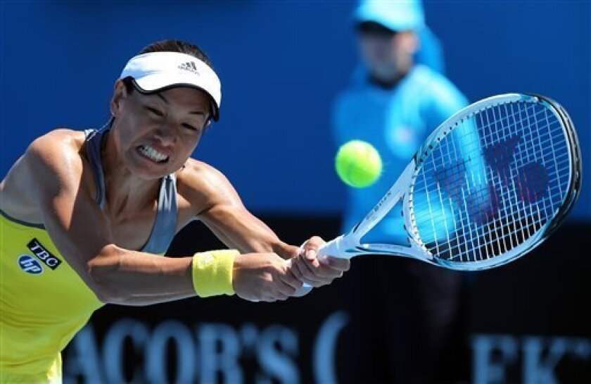 Japan's Kimiko Date-Krumm hits a backhand return to Russia's Nadia Petrova during their first round match at the Australian Open tennis championship in Melbourne, Australia, Tuesday, Jan. 15, 2013. (AP Photo/Greg Baker)