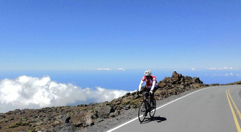 Arnie Cooper rides above the clouds at about 9,000 feet, near the completion of his 37-mile ride and his goal to make it to the top of Maui's Haleakala volcano.