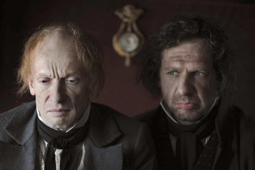 Money lender (Anton Adaskinsky) and Faust (Johannes Zeiler).
