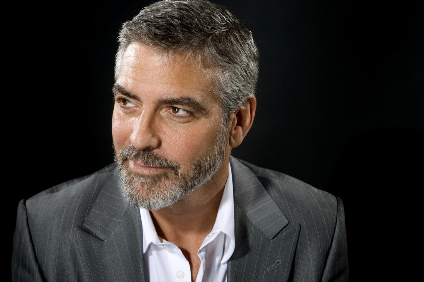 George Clooney. The name says it all: the films, the awards, the looks. We reflect on the actor's career. By Christy Khoshaba