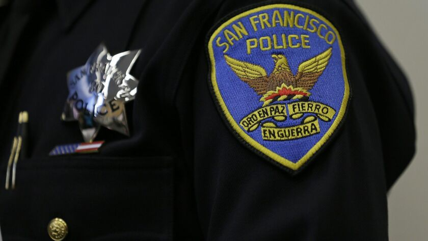 FILE - This April 29, 2016, file photo shows a patch and badge on the uniform of a San Francisco pol
