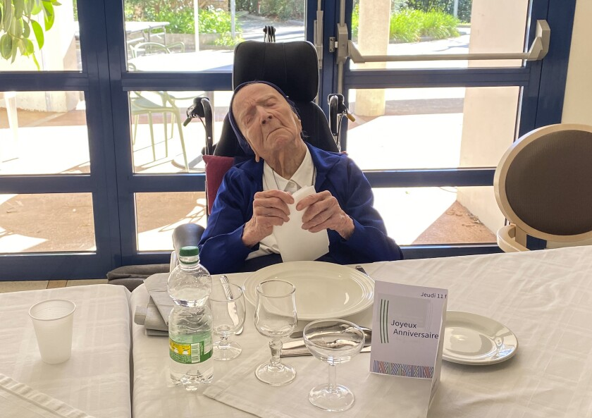 This photo provided by the Sainte-Catherine Laboure care home communications manager shows Lucile Randon, Sister Andre's birth name, waiting for the birthday lunch in Toulon, southern France, Thursday, Feb. 11, 2021. Sister Andre, believed to be the world's second-oldest person, was celebrating her 117th birthday on Thursday. (Sainte-Catherine Laboure care home/ David Tavella via AP)