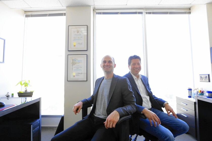 Stephen Rischall, left, and Matt Stadelman co-founded 1080 Financial Group, a small Sherman Oaks firm that promises to act in the best interest of the client.