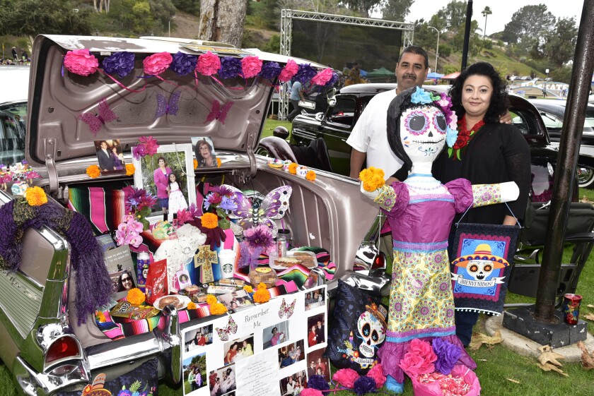 Jaime and Donna Ortega honor their families in the tradition of Dia de los Muertos