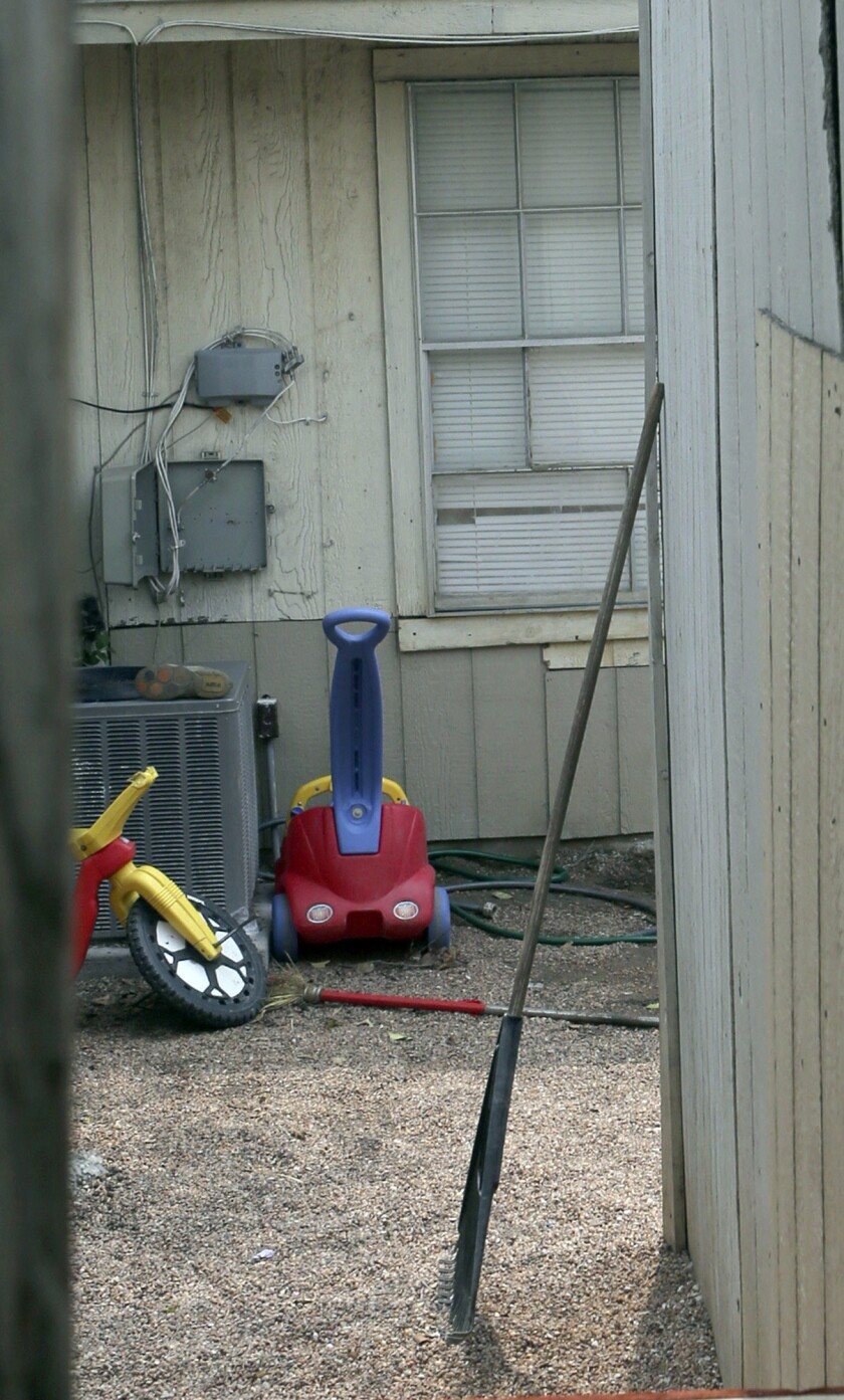 This is the backyard of the townhouse in San Antonio, Texas, where children were allegedly chained up. Authorities say they have arrested a woman who is the mother of six of eight children who were found unsupervised in the middle of the night at the San Antonio home.
