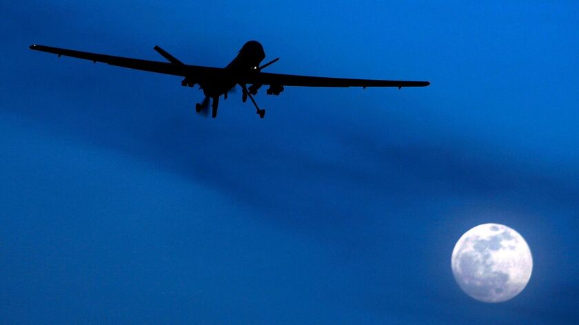 FILE - In this Jan. 31, 2010 file photo, an unmanned U.S. Predator drone flies over Kandahar Air Fie