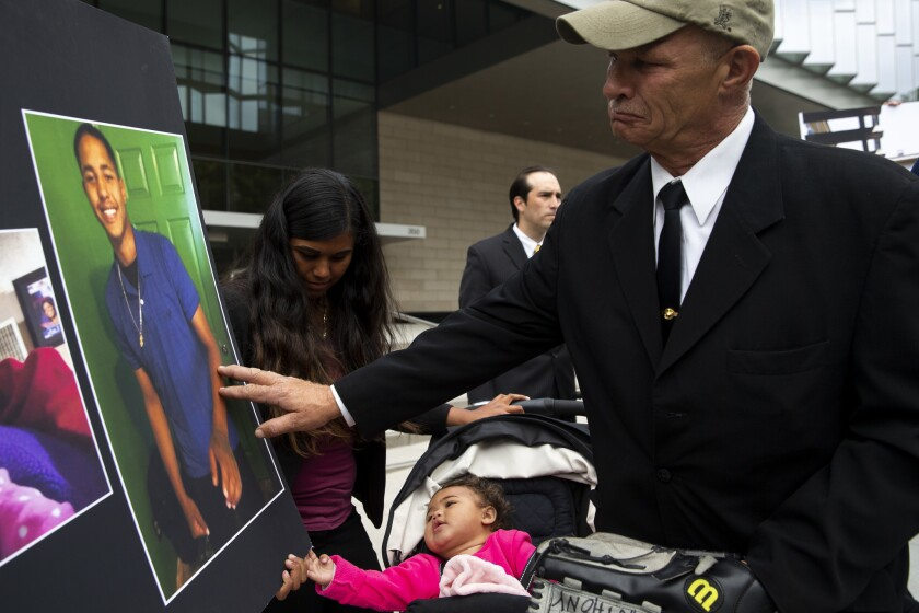 LOS ANGELES, CALIF. - MAY 02: Violet, the young daughter of the late Anthony Weber, reaches out to