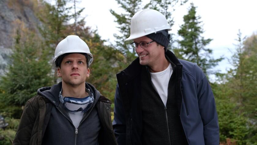 "Jesse Eisenberg, left, and Alexander Skarsgard in the movie ""The Hummingbird Project."""