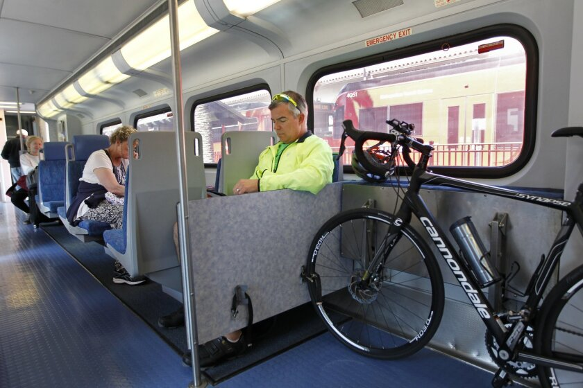 Mayor Faulconer's Climate Action Plan calls for increasing the number of people who commute by bicycle to 6 percent in 2020 and 18 percent in 2035. Shown: Norm Williams reads a tablet during his commute on the Coaster from downtown San Diego to Carlsbad
