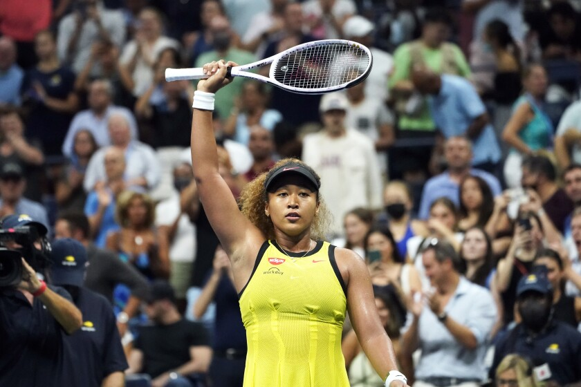Naomi Osaka, of Japan, acknowledges the crowd during her match with Marie Bouzkova, of the Czech Republic, during the first round of the US Open tennis championships, Friday, Aug. 30, 2021, in New York. (AP Photo/Elise Amendola)