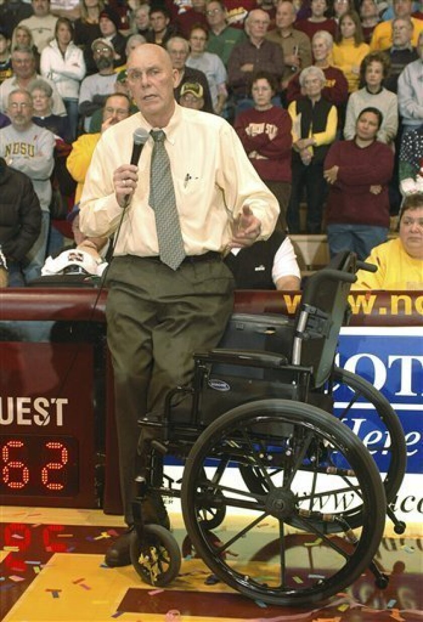 Northern State head coach, Don Meyer, talks to the crowd following his 903rd win Saturday, Jan. 10, 2009 at the Barnett Center in Aberdeen, S.D. The victory makes Meyer the winningest coach in NCAA college basketball history. (AP Photo/Doug Dreyer)