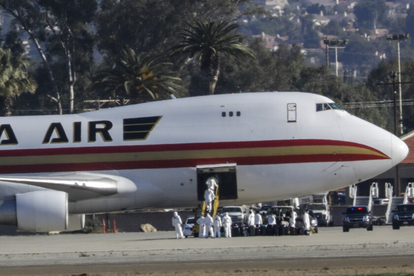 Airplane carrying U.S. evacuees from Wuhan, China, lands at Riverside air base