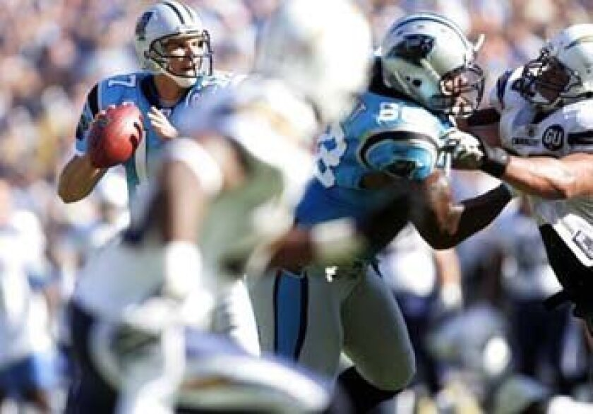 Jake Delhomme drops back to throw to Dante Rosario for the game-winning TD.
