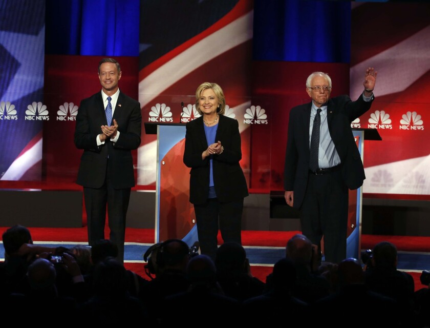 Democratic presidential candidates Martin O'Malley, left, Hillary Clinton and Bernie Sanders before their debate in South Carolina.