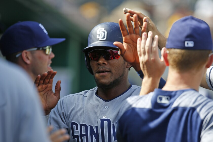 PITTSBURGH, PA - MAY 20: Franchy Cordero #33 of the San Diego Padres celebrates after scoring on a bunt single in the ninth inning against the Pittsburgh Pirates during the game at PNC Park on May 20, 2018 in Pittsburgh, Pennsylvania. (Photo by Justin K. Aller/Getty Images) ** OUTS - ELSENT, FPG, CM - OUTS * NM, PH, VA if sourced by CT, LA or MoD **