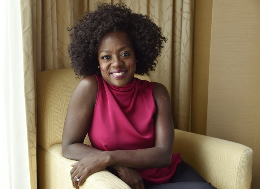 FILE - Viola Davis poses for a portrait at the Ritz-Carlton Hotel during the Toronto International Film Festival in Toronto on Sept. 9, 2018. Davis has been named Woman of the Year by Harvard University's Hasty Pudding Theatricals. The Oscar-, Emmy- and Tony-winning actor is being honored April 22 in an online ceremony that will include a roast, a discussion and a speech from Davis as she is presented with her ceremonial pudding pot. (Photo by Chris Pizzello/Invision/AP, File)