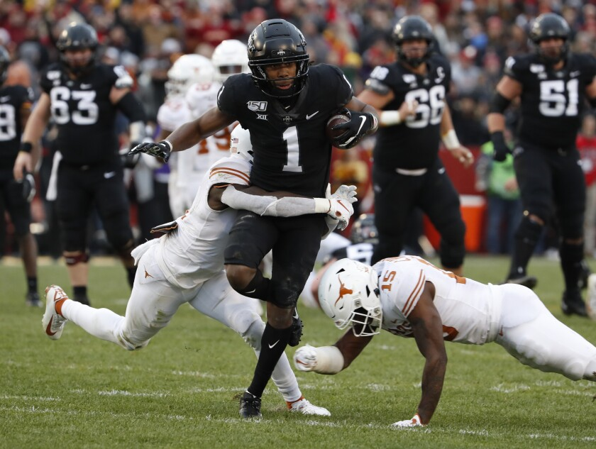 Iowa State wide receiver Tarique Milton is tackled by Texas defensive back D'Shawn Jamison and defensive back Chris Brown.