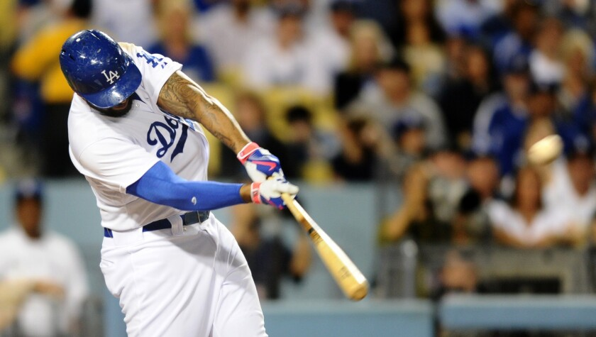 Matt Kemp takes Giants ace Madison Bumgarner deep for a two-run home run in the first inning Tuesday at Dodger Stadium.