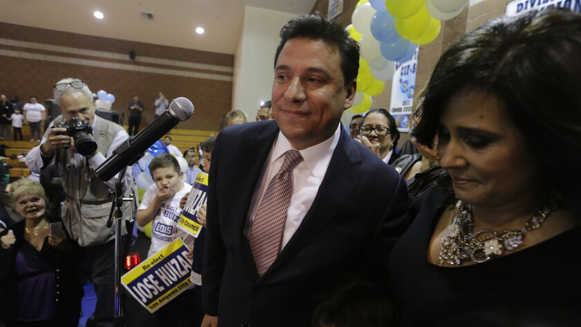 Los Angeles City Councilman Jose Huizar with his wife, Richelle, at his election night party in 2015. Richelle Huizar says she is ending her campaign for his seat.