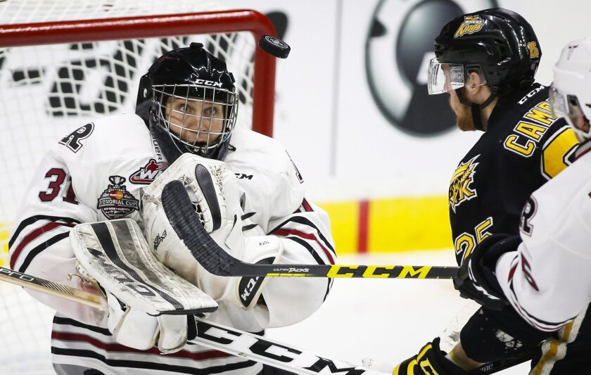 Brandon Wheat Kings' Duncan Campbell, right, watches as Red Deer Rebels goalie Rylan Toth stops a shot during the third period of a CHL Memorial Cup hockey game Wednesday, May 25, 2016, in Red Deer, Alberta. (Jeff McIntosh/The Canadian Press via AP)