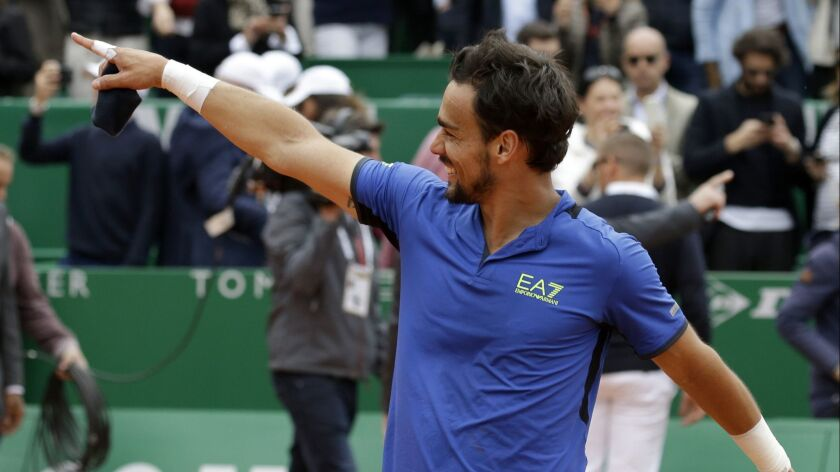 Italy's Fabio Fognini celebrates after defeating Serbia's Dusan Lajovic in the men's singles final m