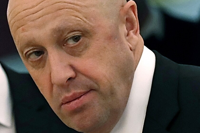 FILE - In this July 4, 2017 file photo, Russian businessman Yevgeny Prigozhin is shown prior to a meeting of Russian President Vladimir Putin and Chinese President Xi Jinping in the Kremlin in Moscow, Russia. The Justice Department is moving to drop charges against some Russian companies that were accused of funding a social media campaign to sway American public opinion during the 2016 U.S. presidential election. (Sergei Ilnitsky/Pool Photo via AP, File)