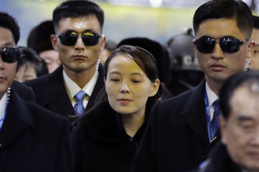 FILE - In this Feb. 9, 2018, file photo, North Korean leader Kim Jong Un's younger sister Kim Yo Jong, center, arrives at the Jinbu train station in Pyeongchang, South Korea. As North Korea goes back to its pattern of pressuring South Korea to get what it wants from the United States, the powerful sister of leader Kim Jong Un has emerged as the face of its campaign of mixing weapons demonstrations and peace offers. (AP Photo/Lee Jin-man, File)