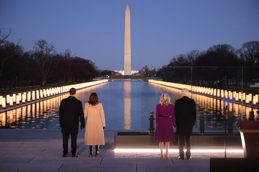 Douglas Emhoff, Kamala Harris, Jill Biden and Joe Biden stand at the Lincoln Memorial Reflecting Pool.