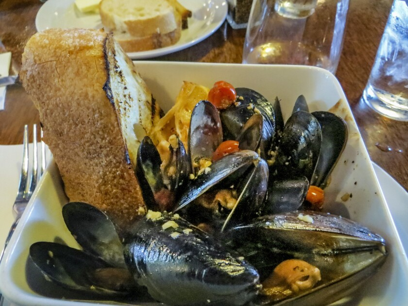 The pan-roasted mussels at Dempsey's Restaurant & Brewery.