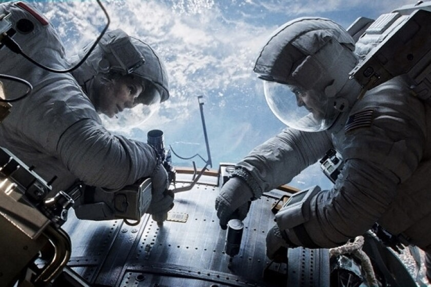 """This publicity photo courtesy of Warner Bros. Pictures shows Sandra Bullock, left, as Dr. Ryan Stone and George Clooney as Matt Kowalsky in Warner Bros. Pictures¿ sci-fi thriller ¿Gravity."""""""