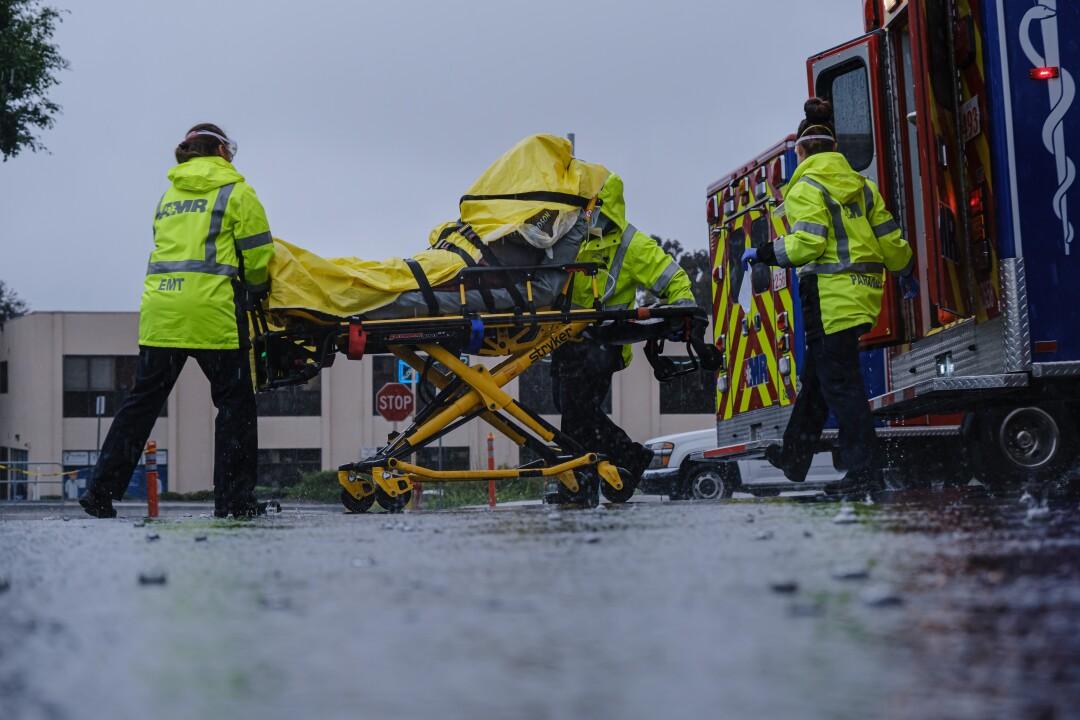 EMTs unload a patient