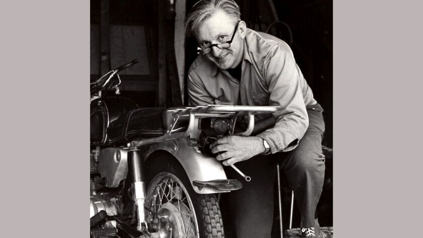 Robert Pirsig working on a motorcycle in 1975.