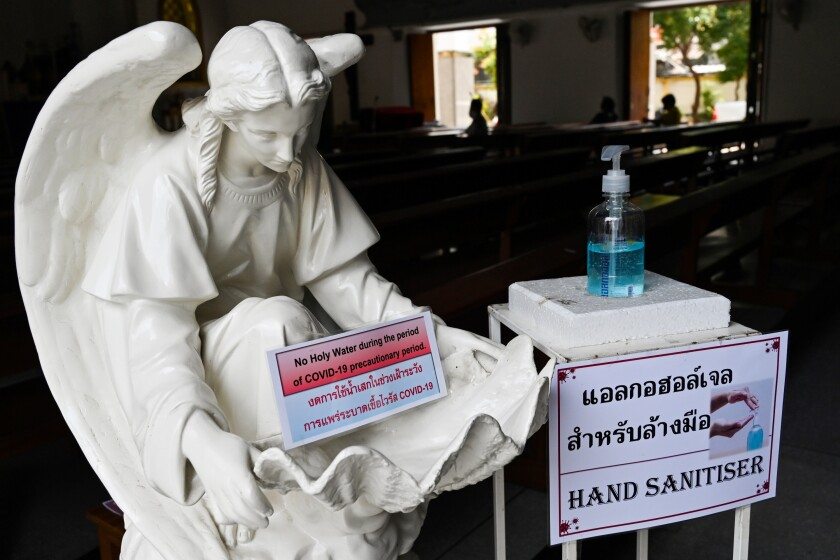Hand sanitizer is installed the Good Friday service at a church in Bangkok on April 10, 2020.